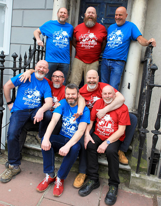 Eight bears in Brighton Bear Weekend t-shirts